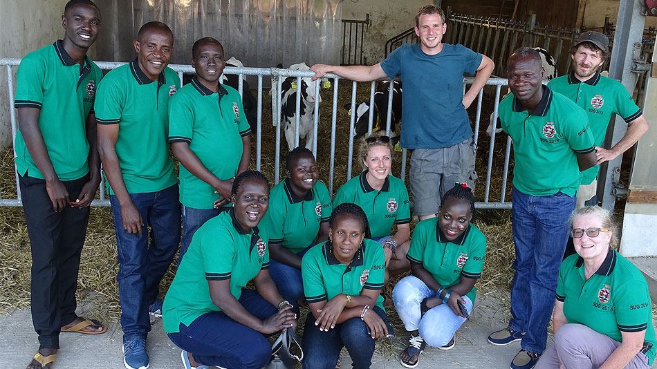 Photo of a group of participants in front of a cowshed.